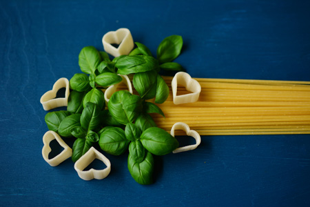 spaghetti with basil and heart shaped noodles